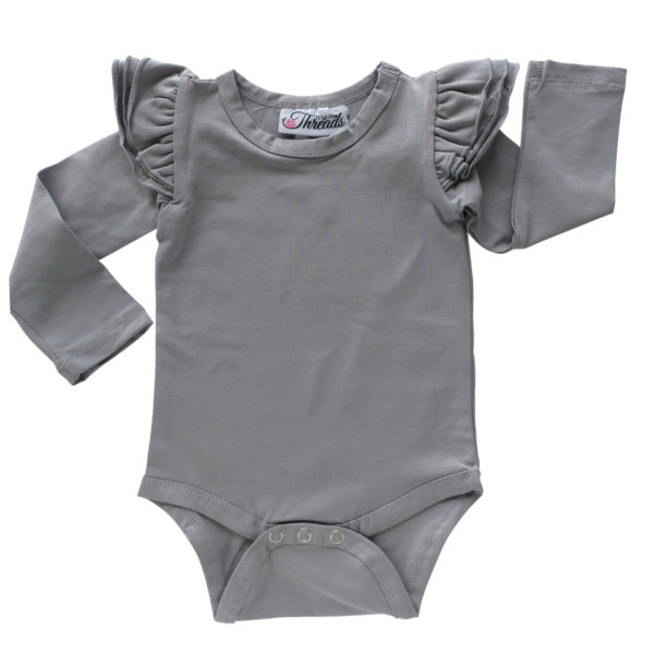 This Soft Grey Flutter Bodysuit / Onesie pairs wonderfully with our Skirts and Pinnys.The always popular long sleeve style is perfect for our Australian climate, protecting your little one's from the sun. We've chosen a perfect blend of 95% cotton and 5% elastane because of it's durability, comfort and quality feel.