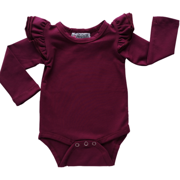 This Wine Flutter Bodysuit / Onesie pairs wonderfully with our Skirts and Pinnys.The always popular long sleeve style is perfect for our Australian climate, protecting your little one's from the sun. We've chosen a perfect blend of 95% cotton and 5% elastane because of it's durability, comfort and quality feel.